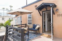 Private deck attached to your upstairs unit. Perfect for relaxing during the day or night with the sound of the ocean in the background.