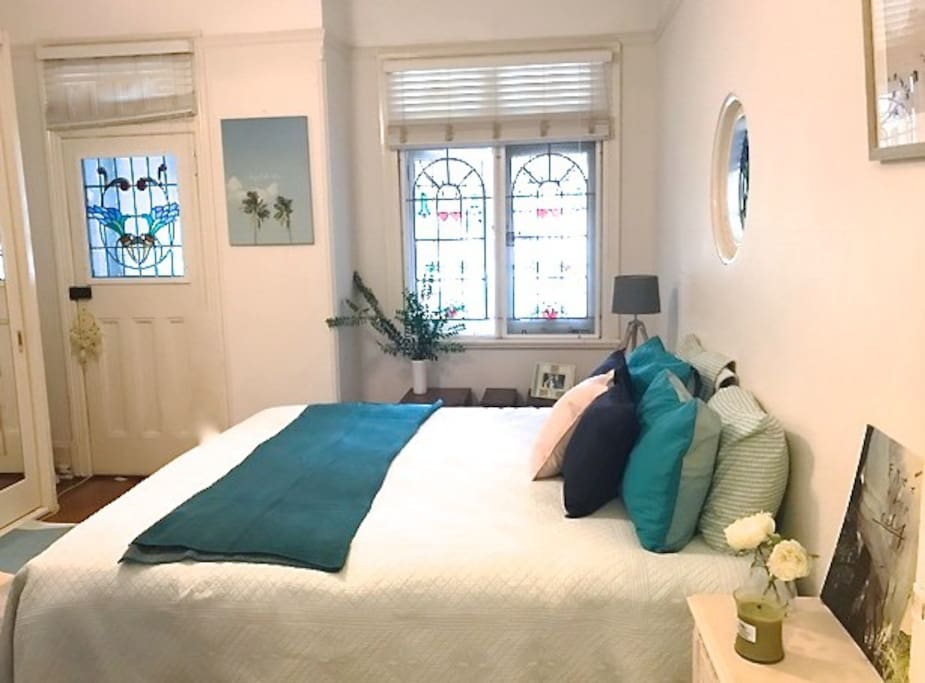 Master Bedroom with King size bed and separate access and beautiful headlight windows