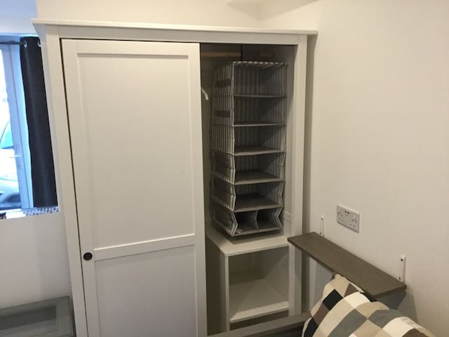Brand new modern Ikea wardrobe with plenty of space for coats / clothes / shoes etc.