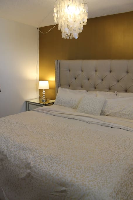 Bedroom with a King Bed. Two night stands.