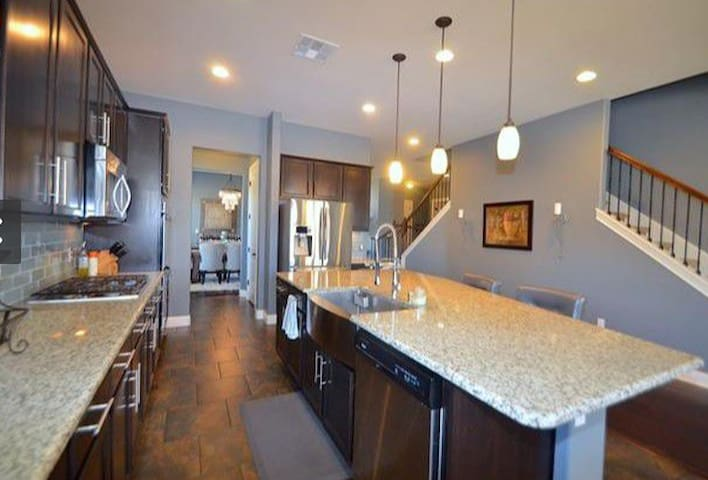 Kitchen, fully stocked Dining table seats 10 4 bar stools around counter & breakfast tables seats 4