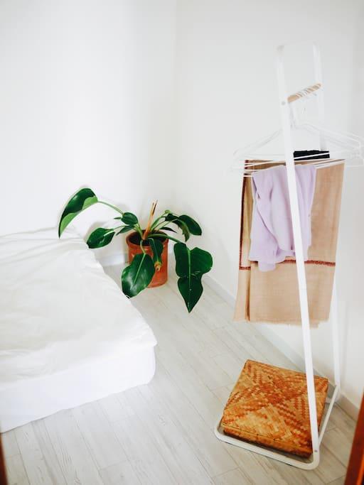 Hanger and basket for belongings.