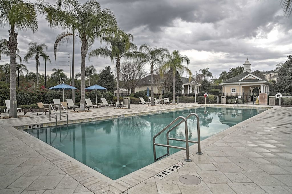 Enjoy the Florida sunshine from the spacious community pool.