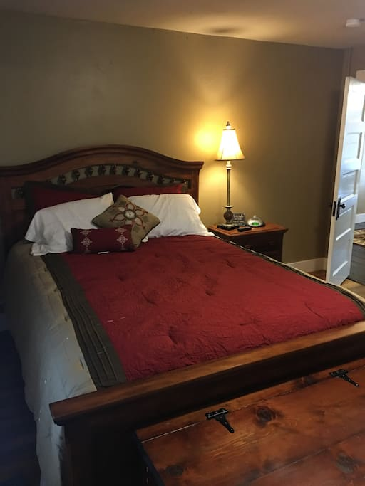 This master bedroom has a queen size bed. It also has nice closet space and a chest with extra pillows and blankets inside. This room also has a tv and smart blue ray DVD player so you can access your Netflix account