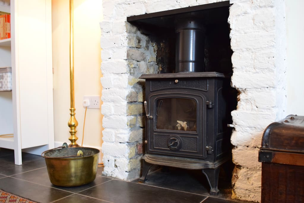 Original 1860's brick fireplace with turf-burning stove for cosy winter evenings at home.