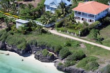 """Situated between """"Moonage Daydream"""" and """"Blue House at d'Cliff"""" Both are AirBnB hosts on Tourist Road 2 bed, 2 bath apt. approx. 70m2 plus a 35m2 terrace with sea view on ground level with private entrance. Disable friendly with ramp and wide doors."""