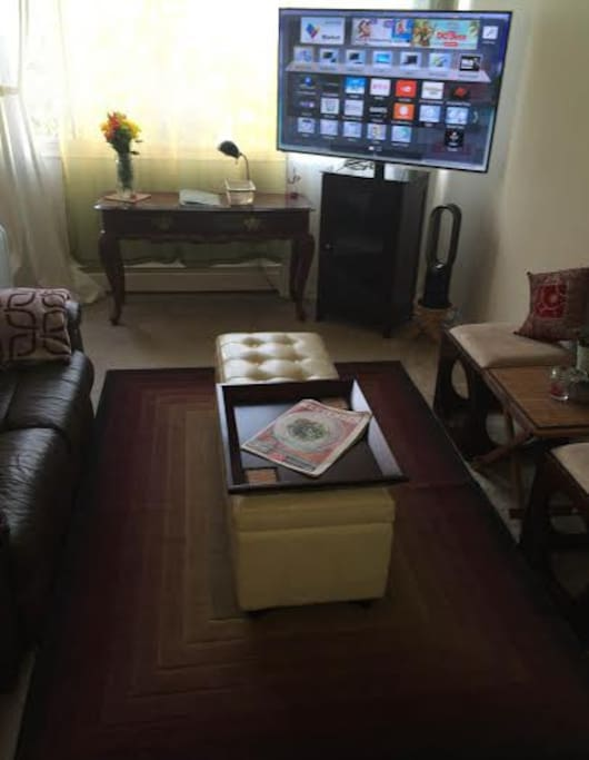 Cozy Living Room, with Large Screen TV, and portable Fan/Heater & A/C units.