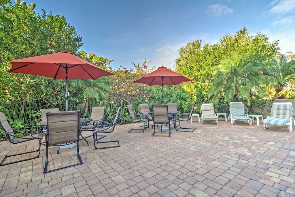 You'll find plenty of seating on the patio by the pool.