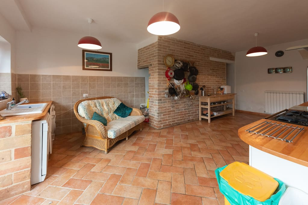 the kitchen is a large airy space with doors out to the garden and patio
