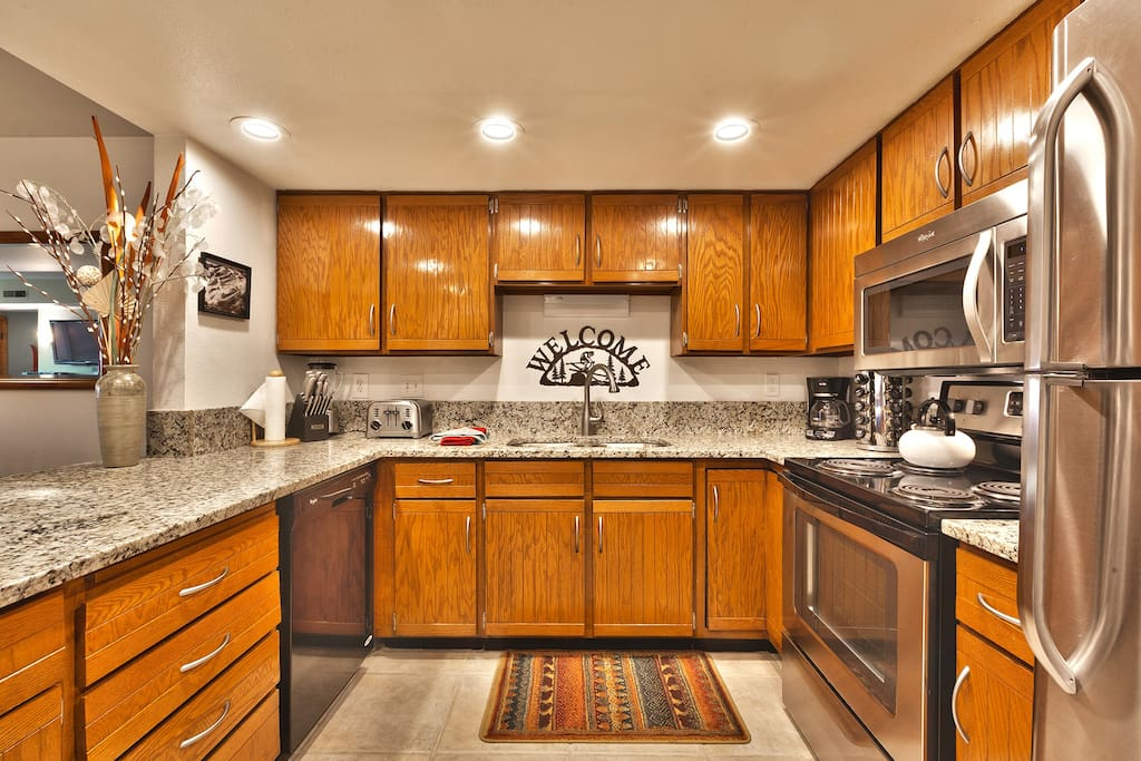 Granite counter tops, Solid Wood Cabinets, Stainless Steel Appliances.