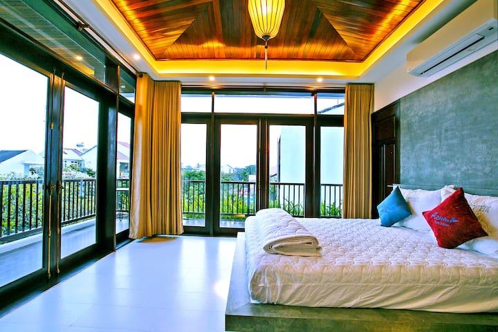 Bedroom with balcony overlooking street