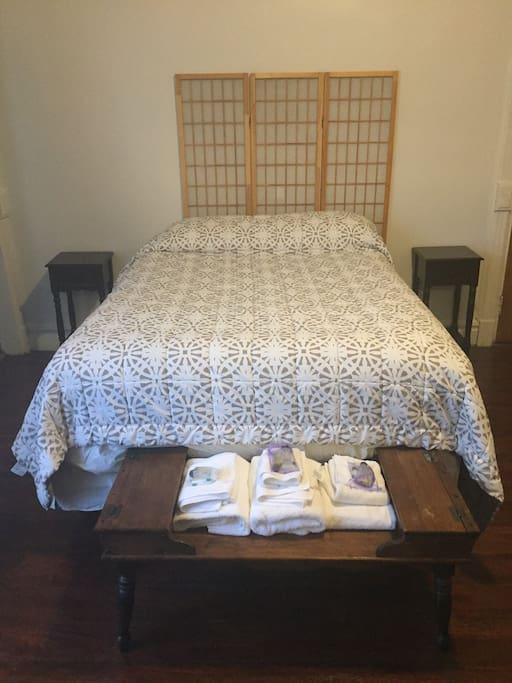 The large room has the queen size bed with extra padding.