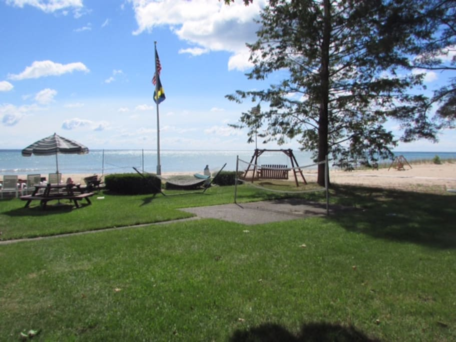 Grounds include swing, picnic areas, firepit, volleyball, badminton, shuffle board, beach.