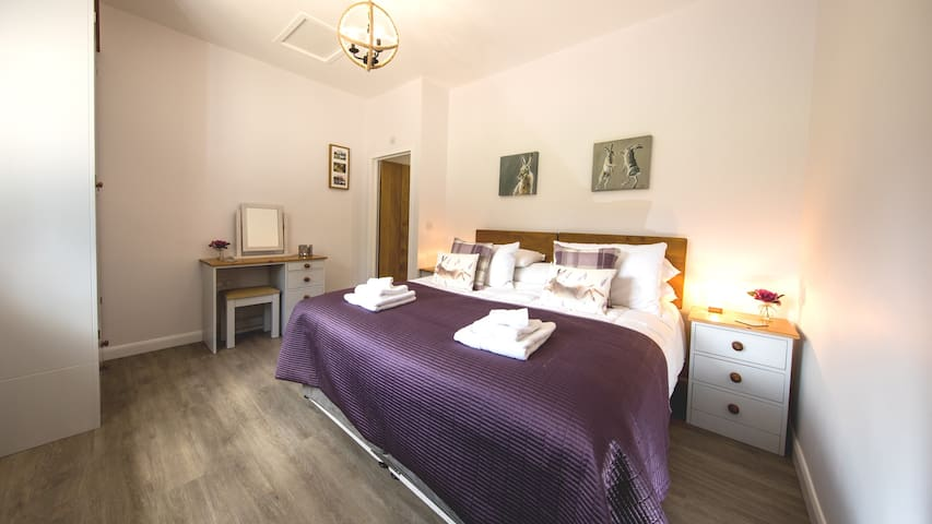 Bedroom 2 is very spacious with a Super King bed with 2 bedsides, or 2 single Beds can be prepared if requested.  It also incudes a large wardrobe and a dresser.
