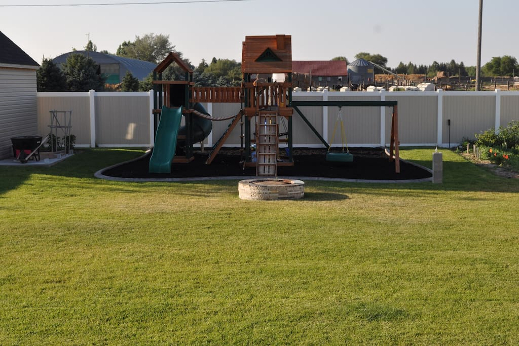 Big fully fenced backyard to relax with a fire pit out back or gas grill on the patio.