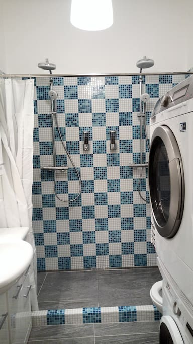 Spacious master bathroom with double shower, hair-dryer, washing machine and clothes dryer. Fresh towels, soap and shampoo provided.