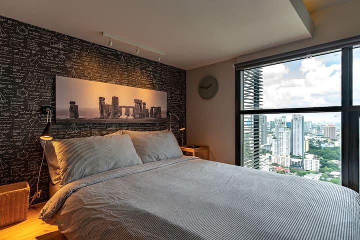 The upper-level bedroom has a queen bed.