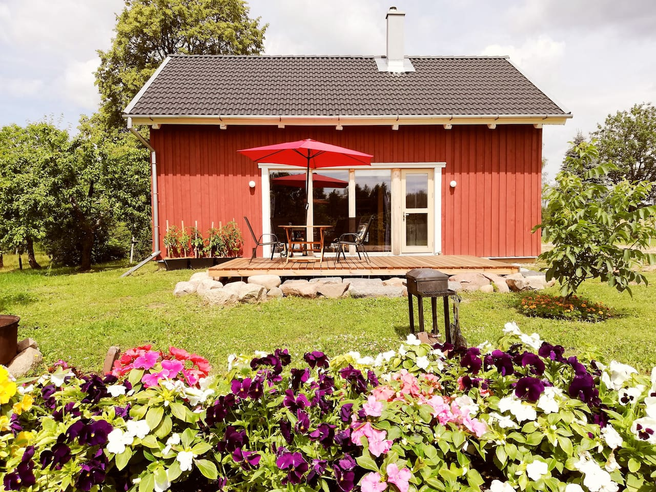 This rustic barn has been given new life with an elegant studio layout providing a spacious living area, convenient corner kitchen and bathroom on the first floor while a second floor bedroom overlooks the main room from a balcony.