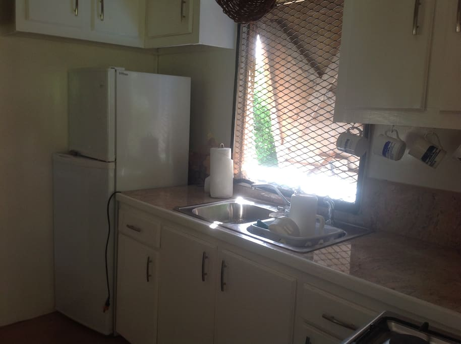 Kitchen : fridge/freezer, gas stove and oven, toaster, kettle, utensils, glass ware, china, cutlery ...