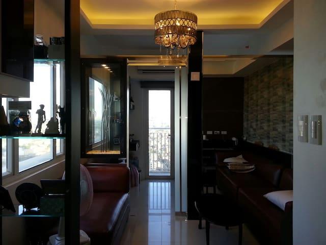 SMDC Sun stylish condo w/ balcony & fast WIFI