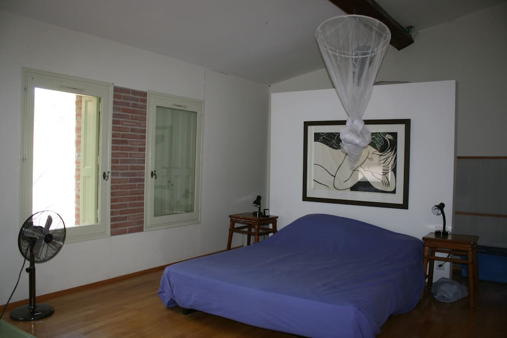 the main bedroom (no.1) with double doors to the little courtyard.