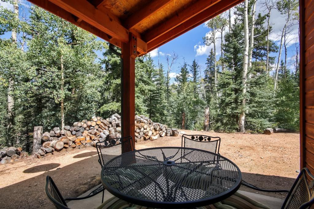 Relax outside on the porch and take in the lovely forest views!