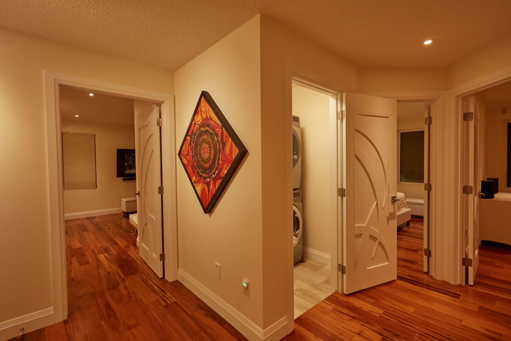 Hallway and Laundry with high end, Steam Washer and Dryer.