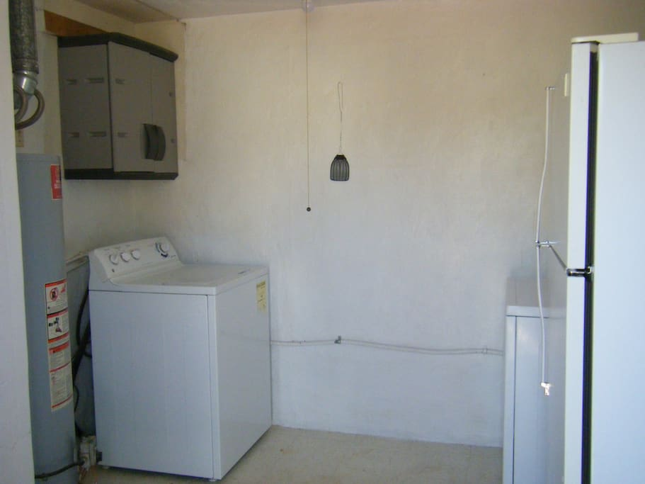WASHER AND DRYER WITH SOAP AND SOFTENER.  IRONING BOARD WITH STEAM IRON.