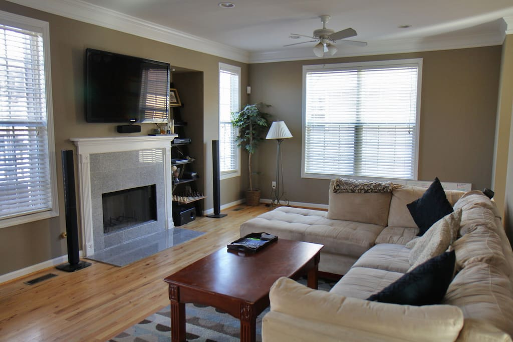 Living room on main floor with hardwoods throughout and large TV with local channels and Amazon FireTV. Plug in a laptop with supplied HDMI