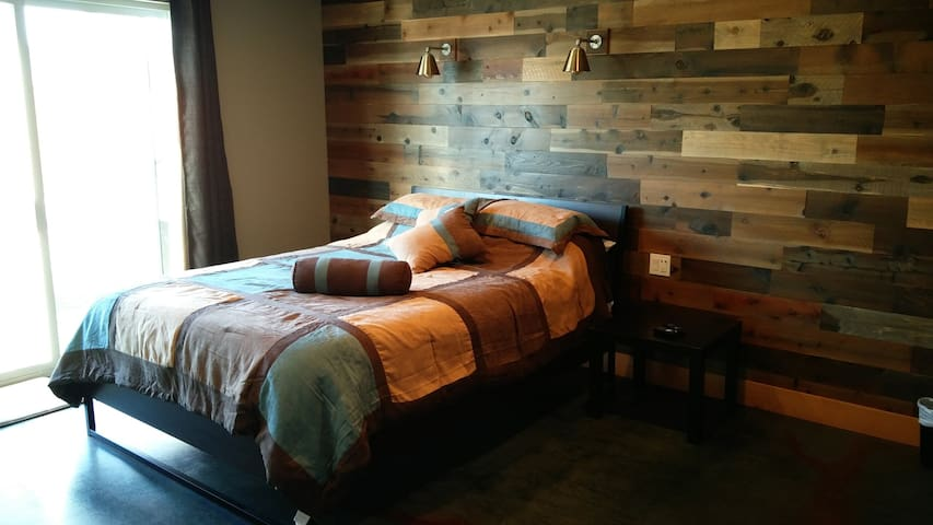 master bed room with old barnwood