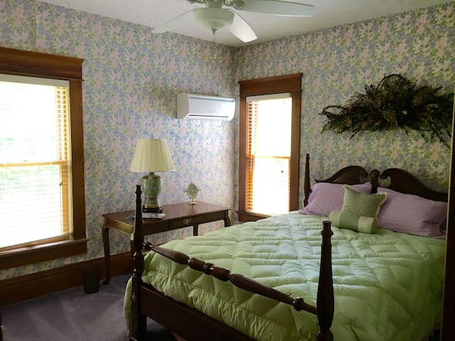 The second story lavender bedroom has a queen size mattress.
