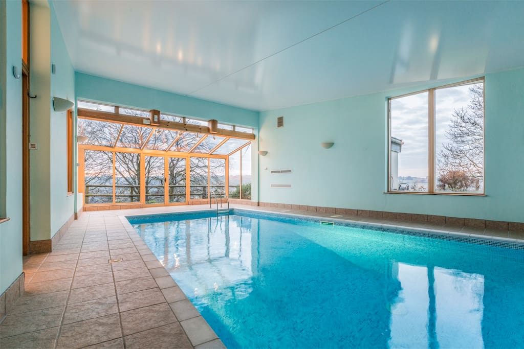 Indoor heated pool which can open up to the sunbathing area at the from with 6 sunbeds