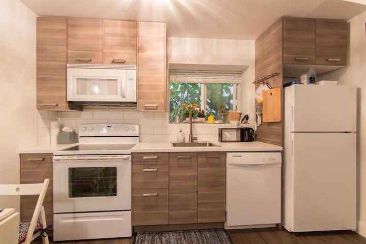 Full kitchen includes microwave/hoodfan, range, dishwasher, refrigerator