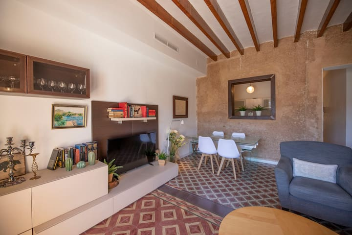 Comfortable living room with old flor tiles and high ceilings