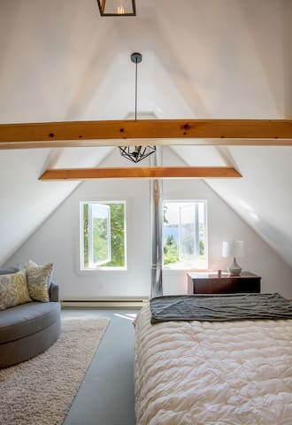 Upstairs master bedroom (queen) with sleeping loft and 2 extra twin mattresses. Sleeps up to 4.