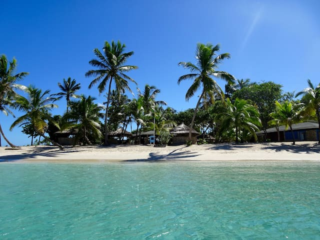 View of the beach bar from the turquoise blue water of Salt Whistle Bay.
