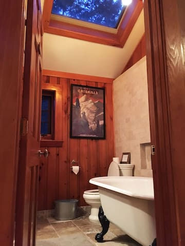 Calgon can take you away in a claw foot tub while you star gaze through the skylight above.