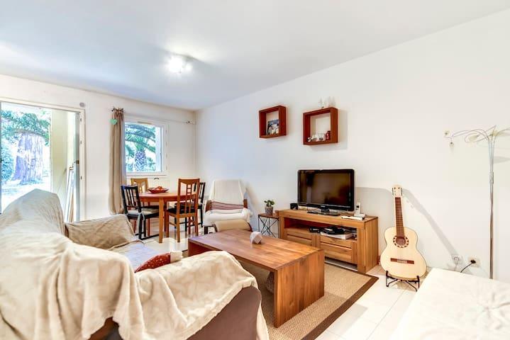 Appartement tout confort en rez de jardin