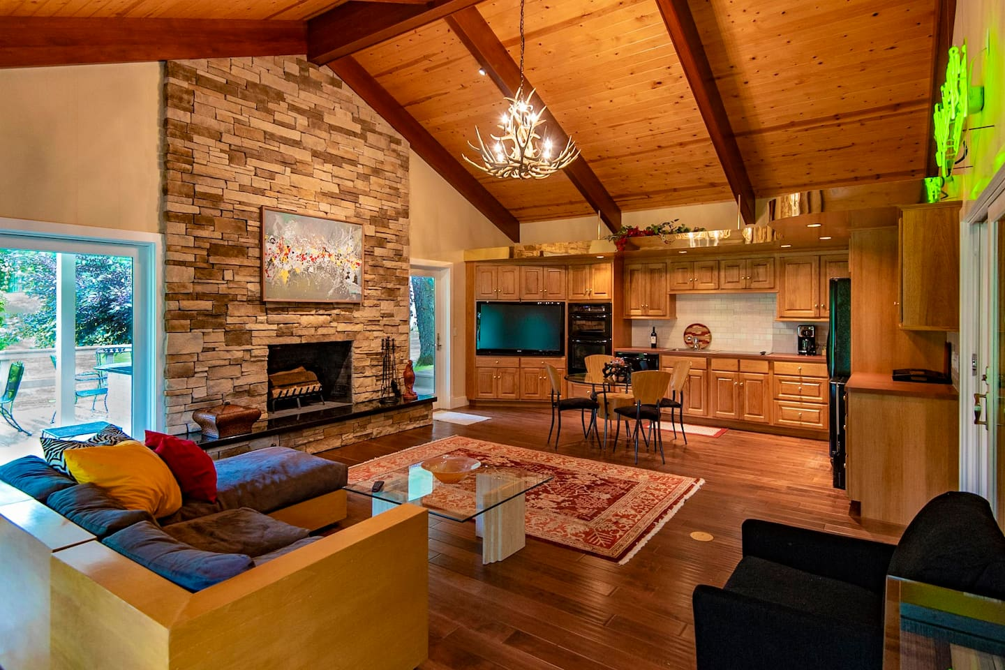 Full kitchen, fireplace, heated floors and access to the deck with built-in grill.