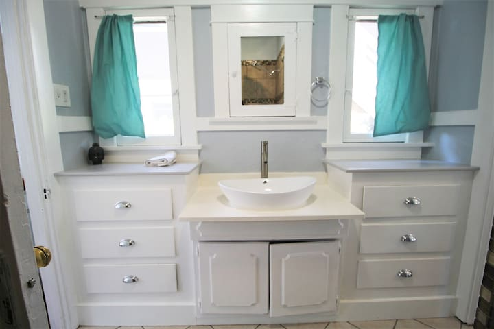 Vessel sink and spa like bath.  Full bathtub and shower!  Craftsman charmer delight!