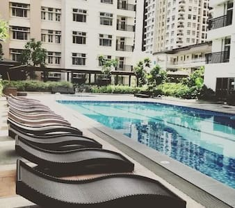 Cozy Condo Room near Gateway Mall - Quezon City