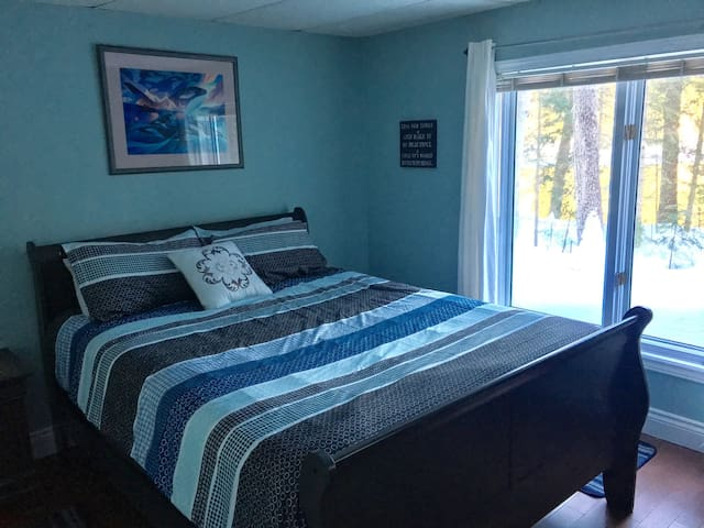 Master bedroom with queen size bed and water view