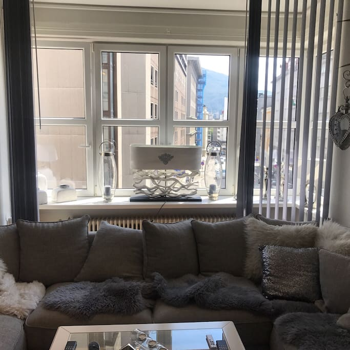 """Livingroom with view to Torgallmeningen and possibility to """"shut down"""" with lamells/markise"""