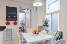 Our little kitchen/dining rooms leads out to a private courtyard