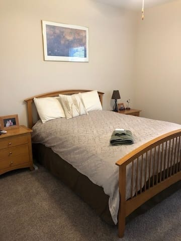 Your room has a very comfortable queen size bed with a feather-top mattress.