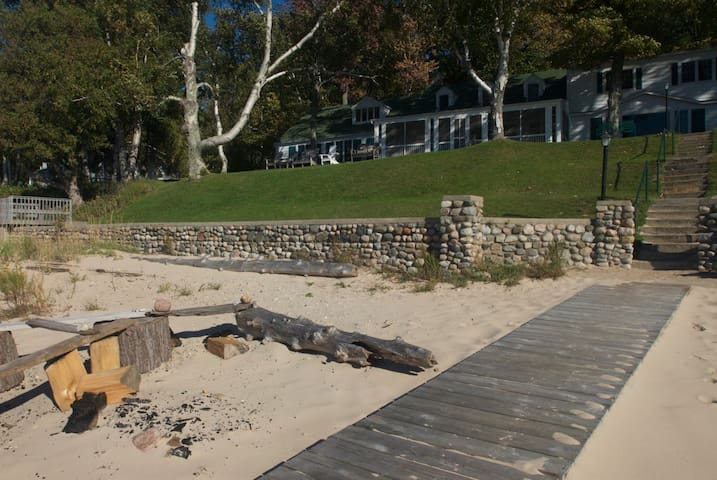 Remnants of a beach bonfire.  The beach changes daily and yearly.  All of our guests have access to our over 700 feet of frontage.  The Petoskey stone hunting is great and the swimming is amazing!  Use of our kayaks, etc. is free for all guests.