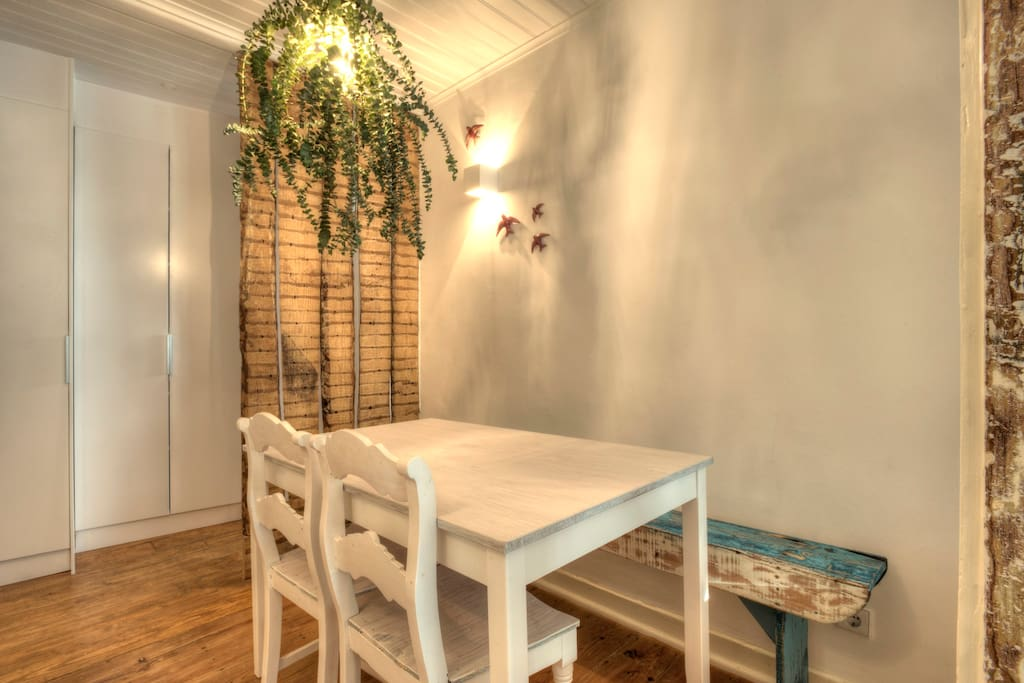 This is the Dining Room with a wooden bench and...