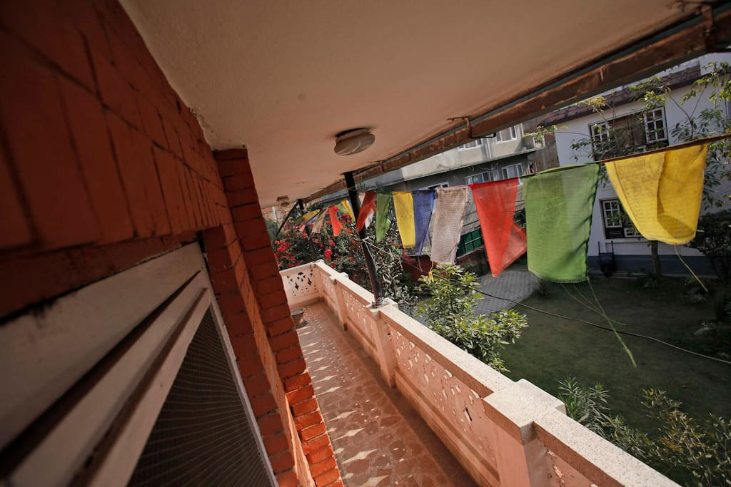 Outside balcony with prayer flags