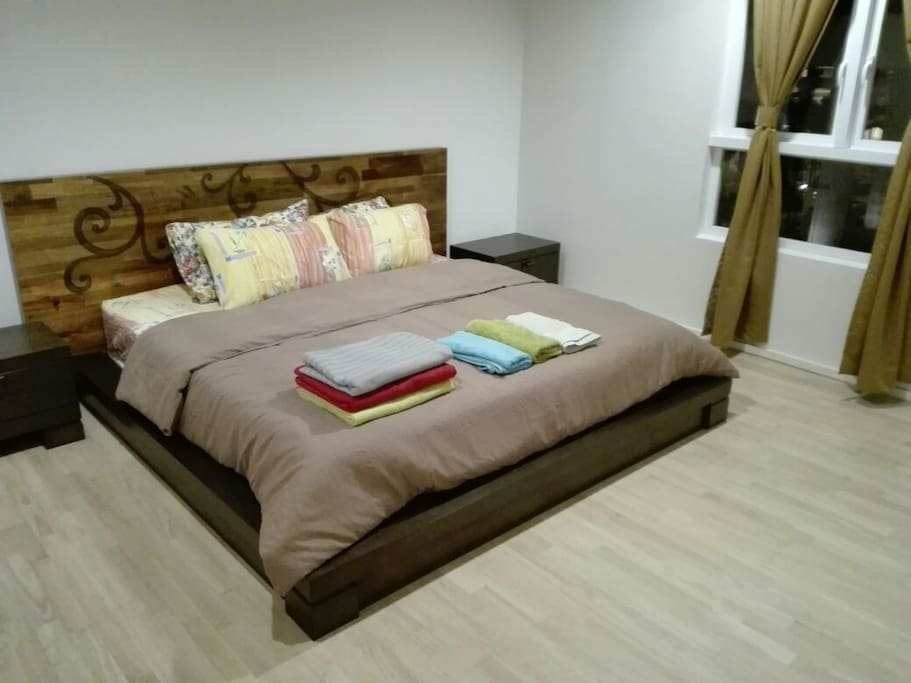 King-sized bed in Master Bedroom