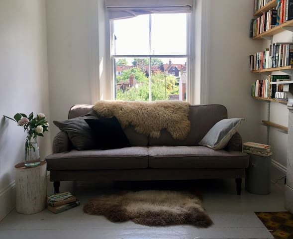 A cosy corner to relax in the ground floor sitting room with 2 open fires